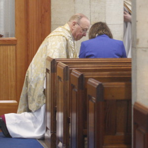 Bishop David Hope symbolically washes the feet of parishioners.