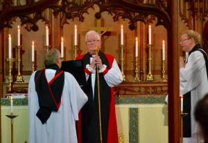 After delivering the Sermon, Bishop Gordon Bates blesses the congregation